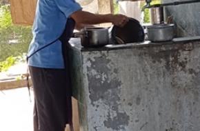 De kok aan de afwas